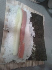 Matte mit Reis udn belag
